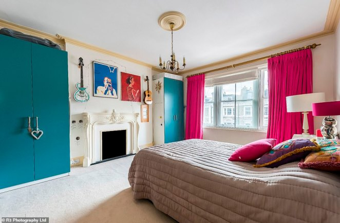 Bedrooms around the house are bright and colourful, decorated with more acoustic and electric guitars and more eclectic art, as well as original period features like the fireplace