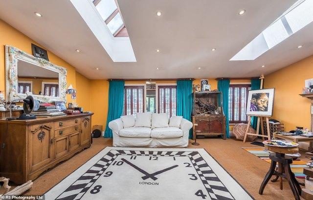 The townhouse Ronnie shared with his family boasts 4,100 sq ft of quirky accommodation in West London, and features off-beat decor including a rug adorned with a picture of a giant clock in one of the sitting rooms