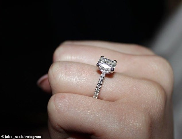 Lovely: He gave his betrothed a custom-made diamond ring (pictured) from Scagnetti Fine Jewellery in Cottesloe. Julie wrote on Instagram: 'How bloody lucky am I. Lachie you are one in a million. Cannot wait to marry you x'