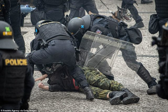 Protesters against the novel coronavirus (Covid-19) measures clash with police in Prague. Armoured and mounted police units along with dog handlers were deployed in the crackdown and water cannon and heavy police vehicles were sent to the square