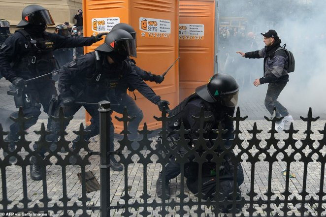Riot police move in against protestors at the Old Town Square as hundreds of demonstrators, mostly football supporters, protest against the Czech government