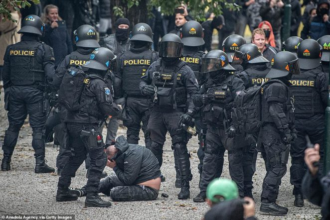 : Protesters against the novel coronavirus (Covid-19) measures clash with police in Prague, Czech Republic on October 18