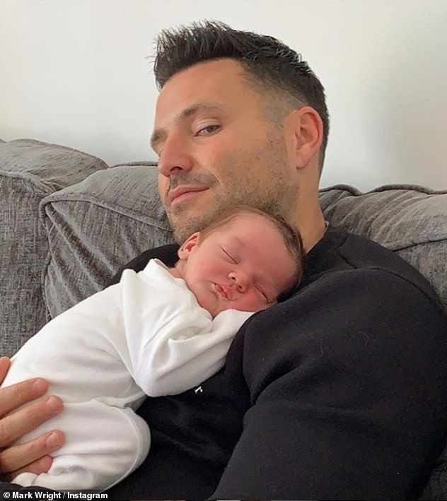 Welcome to the family: Mark captioned the photo: 'The day I met Brody. New member of the clan. Beautiful little boy. @katiefearnehoughx & Tony he is beautiful !! love it already.
