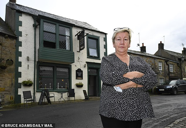 Janet Watson, landlady at the Tillotsons Arms in Chipping, Preston, says she is at 'breaking point' financially, and warns new restrictions imposed on the area will 'push us over the edge'