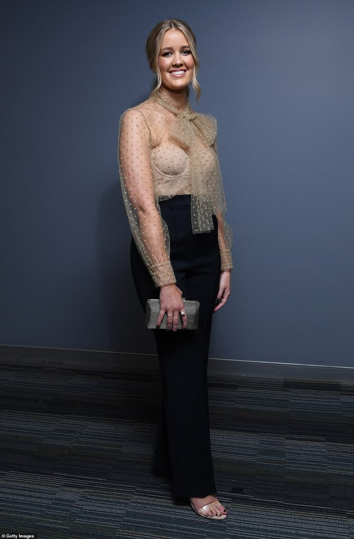 Emily Halverson, partner of Brisbane Lions player Harris Andrews, chose an outfit that was chic but better suited for a boardroom than the biggest night on the Australian football calendar