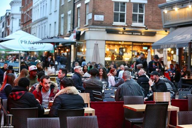 Britons braved the winter chill as they sat outside in the city's expanded beer gardens and enjoyed a night out amid the pandemic