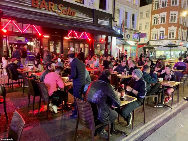 Revellers sat outside bars and restaurants in Soho, central London, as the capital entered day two of the new Tier Two lockdown