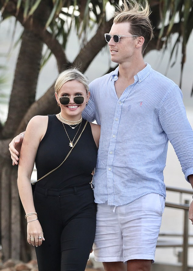 Pals: All eyes were on Alli Simpson (left) on Sunday as she stepped out with a male friend (right) in Burleigh Heads on the Gold Coast