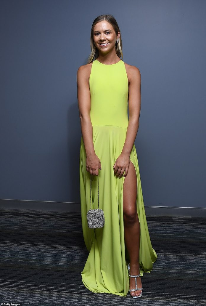 The poor choice of materials caused problems for Ellie Thornycroft, partner of Collingwood's 'Magpies' star Taylor Adams, who opted for a bright green maxi dress made from lycra - the most popular swimwear fabric