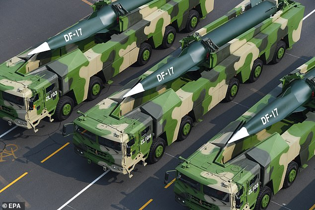 FILE: Military vehicles carrying DF-17 hypersonic missiles pass near Tiananmen Square on October 1, 2019