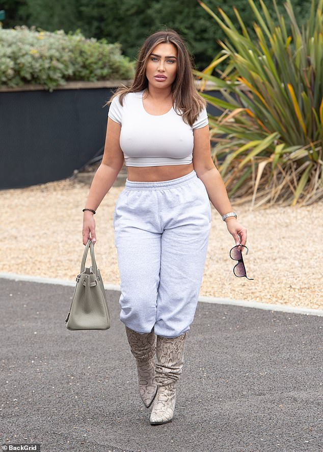 Work it:Lauren Goodger put on an eye-popping display as she went braless in a skimpy white crop top during an outing to a pub in Hertfordshire on Sunday afternoon