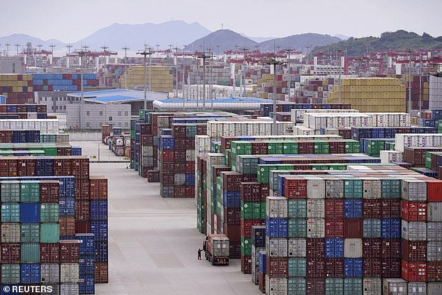 Past the worst? Containers stack up at Shanghai's deep water port. Output in China rose by 4.9 per cent in the third quarter. The data shows almost all sectors of the economy improving