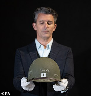 Signed: Tom Hanks' helmet, etched with his signature, from is up for grabsSaving Private Ryan
