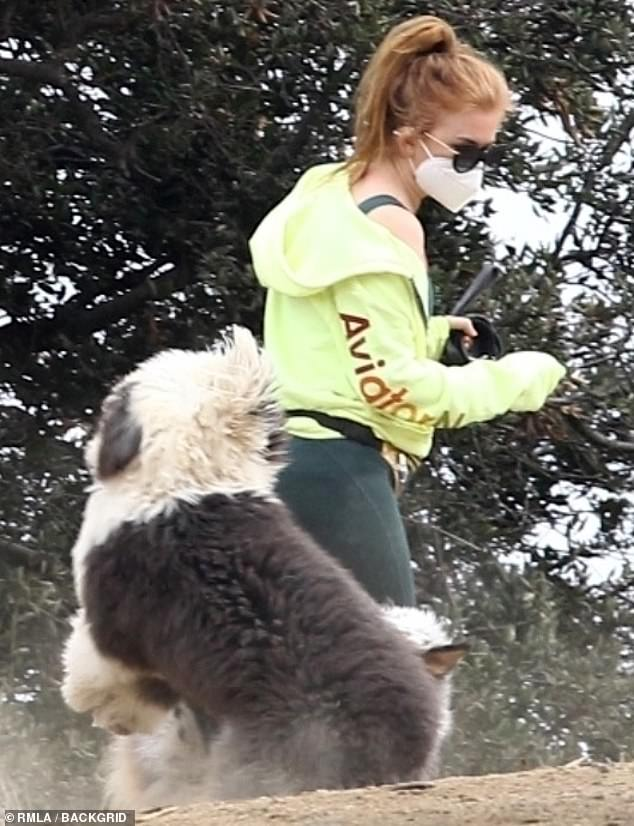 Walking companion: she let her old English Sheepdog run off a leash, while she enjoyed his walk on the side of the street