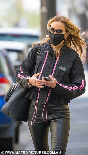 Feel fresh!  Bec Judd showed off her slender figure in leather pants as she rushed to the hairdressing salon in Melbourne on Tuesday, left, before emerging with a new caramel mane, right, after the city relaxed the strict lockdown of the coronavirus.