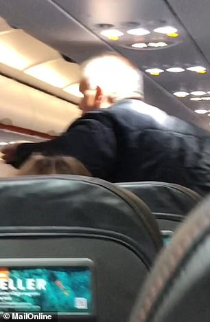 He tells passengers: 'I'm serious, get them off', before shouting: 'Fight back'