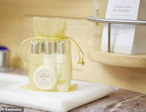 First-class customers will be given an individual amenity bag full of luxury spa products, pictured, when taking a shower