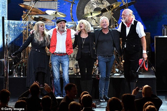 We owe you: Drummer Mick (pictured with L-R Stevie Nicks, John McVie, Christine McVie, Lindsey Buckingham in 2018) has praised Apodacafor uniting people during a difficult year