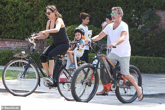 Accident: The businessman was rushed to hospital in early August when he fell from his e-bike while taking a test drive (pictured on a family outing in 2017)