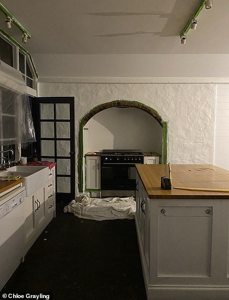 The kitchen needed to be lightened with a coat of paint and some peach-coloured rugs