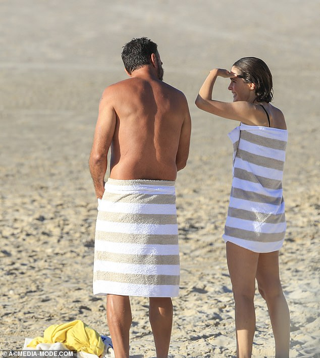 Twinning: Rose and Bobby wrapped themselves in matching white and beige striped towels