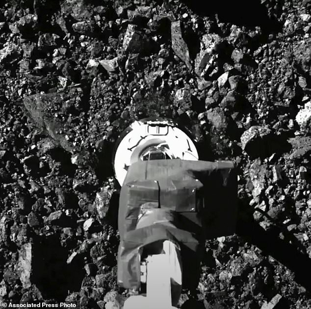 In this image taken from video released by NASA, the Osiris-Rex spacecraft touches the surface of asteroid Bennu on Tuesday, Oct. 20, 2020