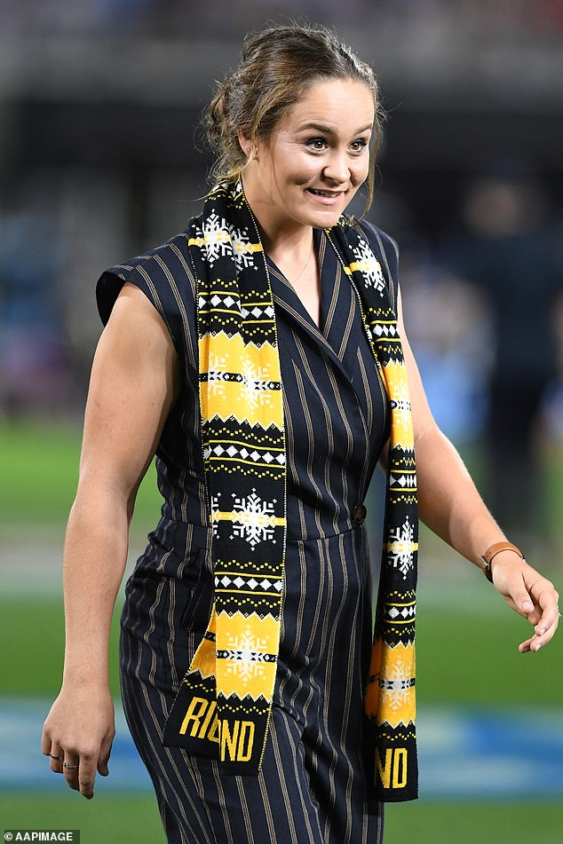 Barty celebrates after Richmond wins the AFL Grand Final on Saturday night. She presented the Premier Cup to the winning side