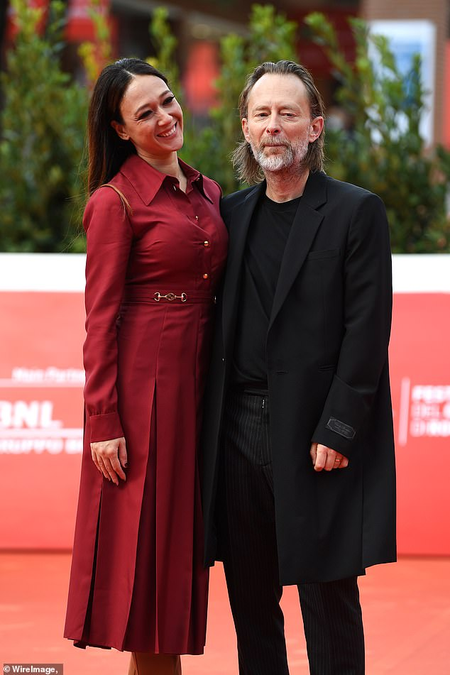 Smitten: The 51-year-old Radiohead front man and 36-year-old Italian actress wrapped their arms around each other as they posed for photos at the socially distant event