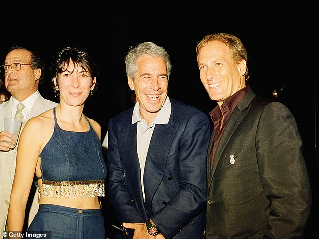 Pictured (left to right):Ghislaine Maxwell, Jeffrey Epstein, and musician Michael Bolton pose for a portrait during a party at President Trump's Mar-a-Lago club, Palm Beach, Florida