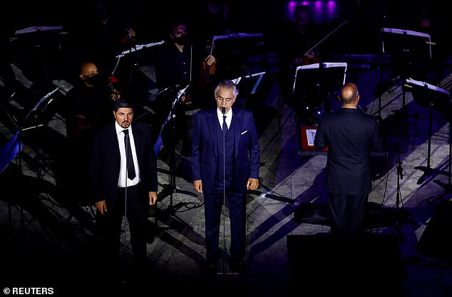Suave: Andrea changed clothes once during the performance and put on a navy blazer that goes with his suit