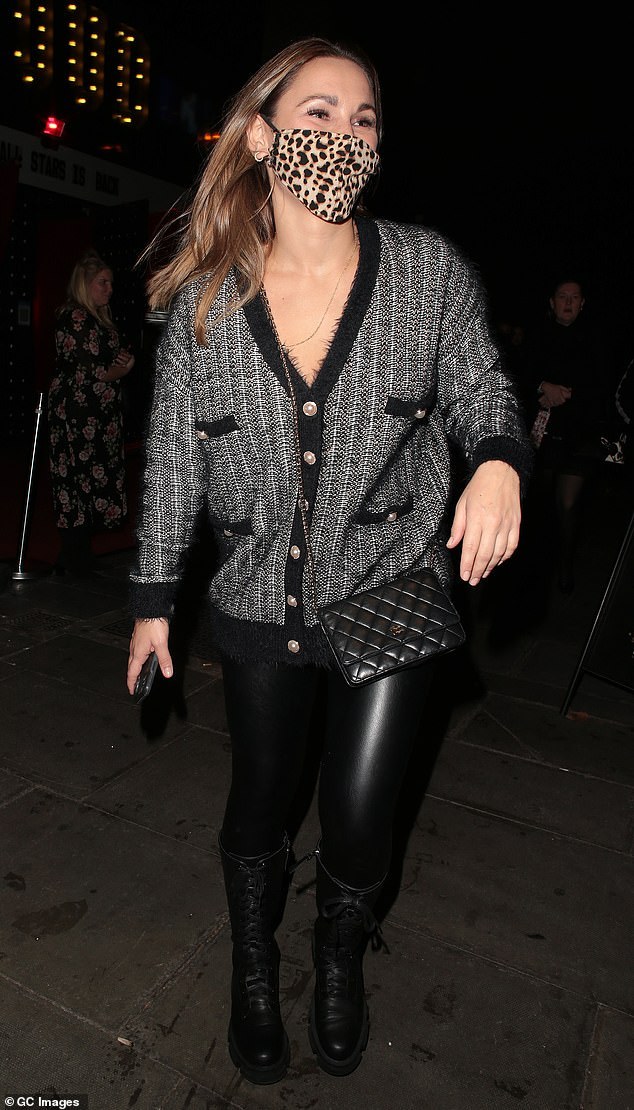 Evening!  Sam looked trendy in a black and gray knitted cardigan and chunky lace-up boots as she drove into town