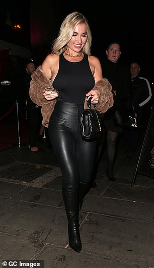 Glam: Billie wore leather boots and styled her blonde braids in soft waves