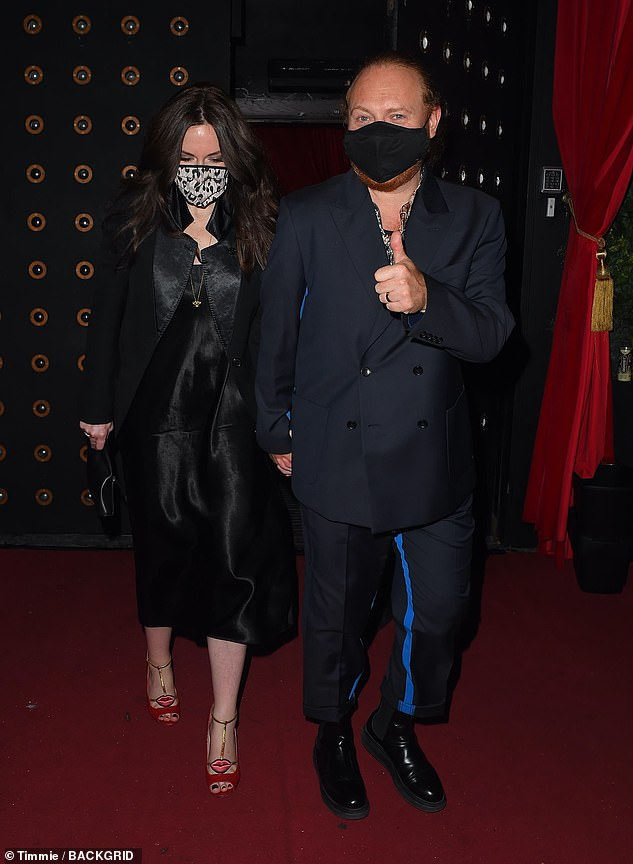 Couple: Leigh Francis also came to town to enjoy the show of Denise, wearing a sleek navy blue suit and his wife who donned a black satin dress and matching coat.
