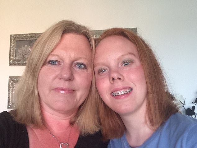 Ms Rogers (left) was not tested for covid-19 during her 17-day stay in intensive care.  Pictured with daughter Lauren