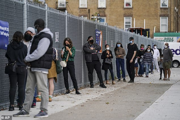 The nation reported more than 83,000 new infections on Friday and Saturday, surpassing the July record of 77,300 new daily cases. A view of patients waiting in line outside a COVID-19 testing center in New York City above on October 7