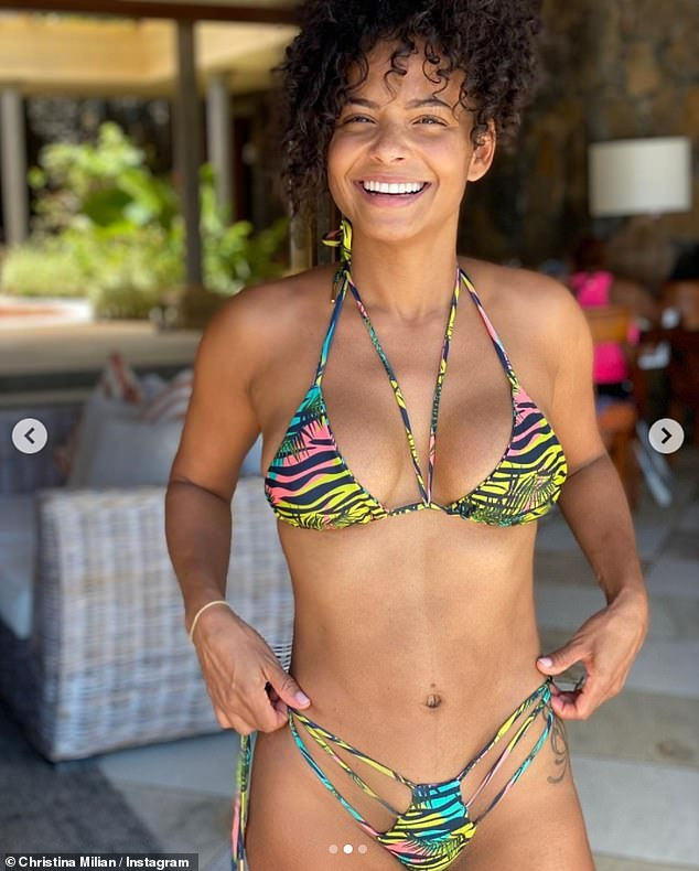 Island life: The AM To PM singer slipped into a tropical tiger-print harness top and a racy cut-out thong bottom that accentuated her washboard abs