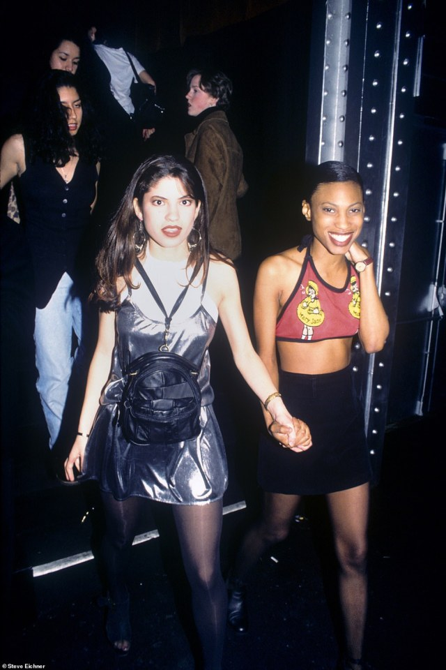 Clubgoers: Two young partygoers are pictured in 1994 walking down the entrance stairway and into a night at the massive Tunnel club. Grinning ear to ear in their rave fashion with anticipation for what magical experience the night may ho