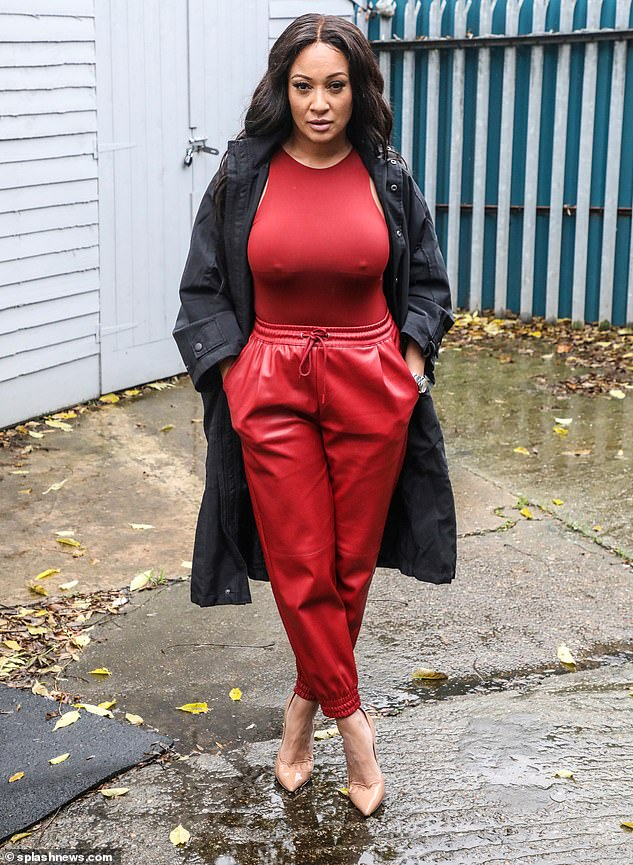 Work it:The 21 Seconds hitmaker added height to her frame with nude pointed heels and wore a long black coat to shelter her from the rain