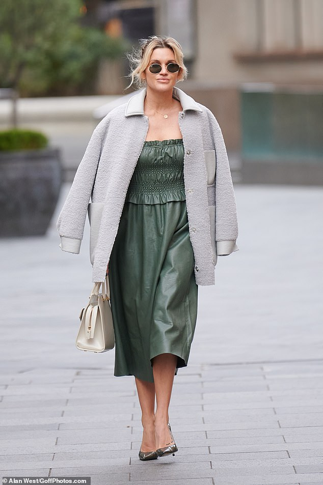 Chic: She added a few inches to her height, wore sky-high House of CB heels and a cozy-looking gray coat over her shoulders