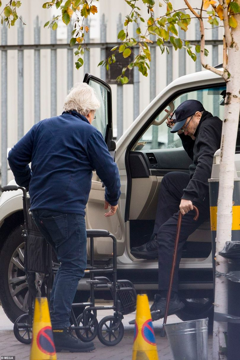 Easy does it: He could not walk without a support as he disembarked the car