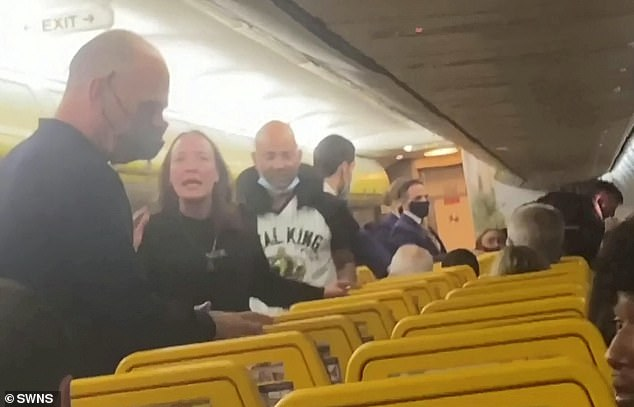 The woman continued to scold another passenger after the scuffle broke down and cabin crew attempted to restore order.