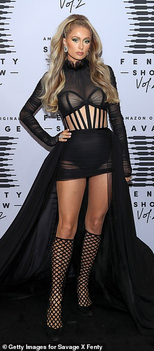 Paris Hilton, 39, rocked a black body suit with a flowing, see-through skirt