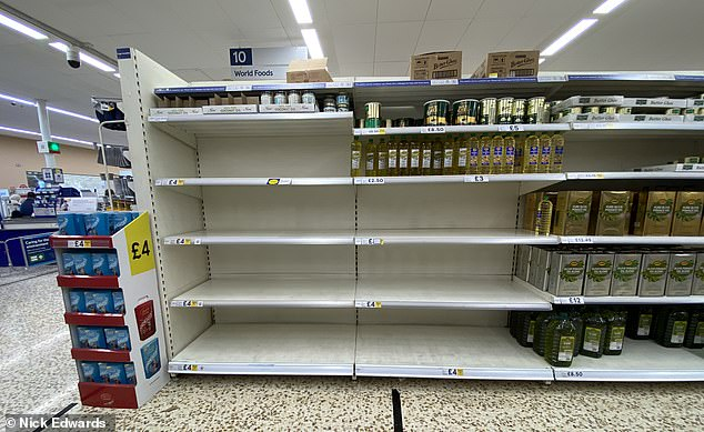 Pictured: cooking oil running out in Tesco Edmonton Tesco Edmonton, North London. Supermarket sales rocketed as coronavirus spread across the UK. The risk and uncertainty caused by the pandemic led people to change their behaviour and stock up on food items because they feared a shortage of supply in future