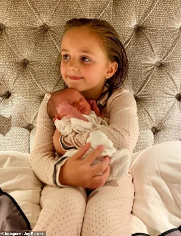 Doting sibling: The Formula One heiress' husband Jay Rutland also uploaded sweet photos of their eldest child Sophia snuggling her younger sister