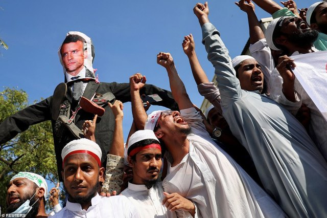 An effigy depicting the French president Emmanuel Macron is seen as Muslims chant slogans denouncing him during a protest in Dhaka, Bangladesh