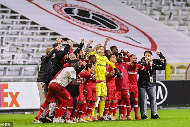 The Belgian team celebrates together on the pitch after their impressive victory on Thursday
