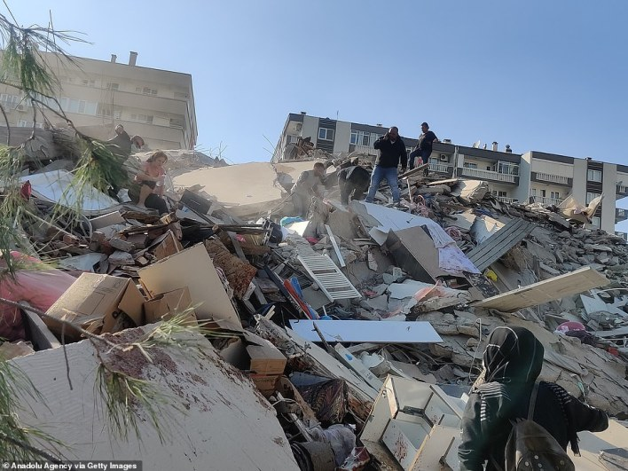 A destroyed building in Izmir, Turkey, after the 7.0-magnitude earthquake in the Aegean today which killed at least 21 people and injured 725 others in Turkey, while injuring at least four people in Greece