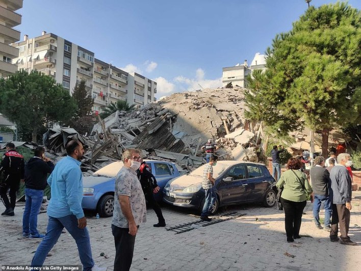 The rubble of a building is heaped on the ground after it collapsed during the Aegean earthquake on Friday
