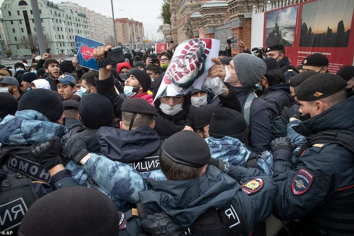 Russian police attempt to break up a demonstration against Emmanuel Macron outside the French embassy in Moscow