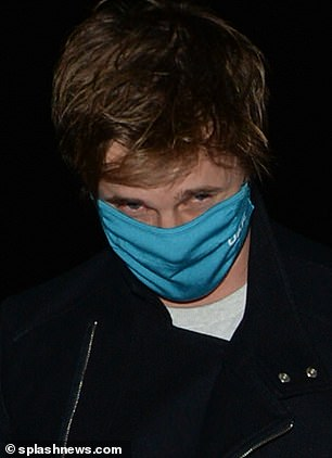 Play it safe: Bradley put on his blue face mask when they went to the restaurant